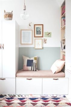 Multifunctional Storage Ideas — AVE Styles white storage bench with leather pulls and a pink cushion with a half painted mint green wall
