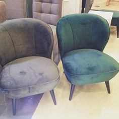 These suede chairs  are so comfortable! The left one, with he grey tones would be a nice chair for the nursery! Soft, comfortable and big enough for the baby and me :)