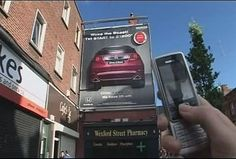 Honda Billboard with SMS and Bluetooth Interaction.  You can start the car in the billboard with your phone.  How cool is that?
