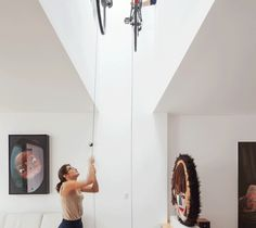 If you live in a loft or just have really high ceilings, you can set up a bike lift. At less than $30, it's a cost effective solution, but it's also extremely stylish. Your friends will definitely be impressed when you lower your Schwinn from the rafters at your next dinner party.