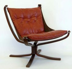 Falcon bentwood chair designed by Sigurd Ressel, upholstered in brick red leather. Only ships to the UK for this piece. However, if you are