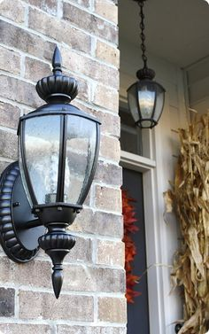Spray paint light fixtures tutorial Outdoor Light Fixtures, Outdoor Lighting, Lighting Ideas, Diy Furniture On A Budget, Painting Light Fixtures, Coach Lights, Paint Brass, Thrifty Decor Chick, Spray Painting