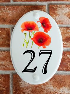 A range of pottery style house plaques feature prints of original artwork from our own sign artists. Hand cast in cultured marble these number plates are weatherproof outdoors. House Number Plates, House Numbers, House Plaques, Floral Motif, Poppies, Original Artwork, Pottery, Home, Ceramica