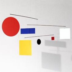 """Flensted Circle Square Mobile Reproduction - Created by Flensted Mobiles as a memento for the Guggenheim Museum in New York.  Made in Denmark. Made of fiberboard leaves and steel rods.  Mobile hangs 14"""" tall and 36"""" wide."""