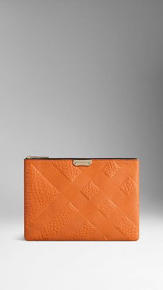 Burberry Copper orange Large Embossed Check Leather Beauty Wallet - A beauty wallet in check-embossed signature grain leather. Discover more accessories at Burberry.com