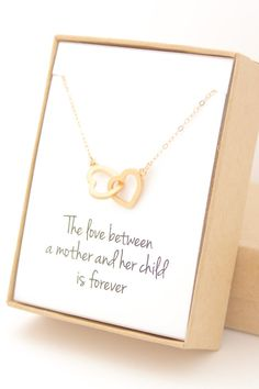 This adorable gold interlocking hearts necklace is perfect for everyday! It would make a great Mother's Day gift or for bridesmaids, birthday or anniversary gifts!