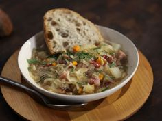 Get this all-star, easy-to-follow Ham, Bean and Bacon Soup with Sauerkraut recipe from Rachael Ray