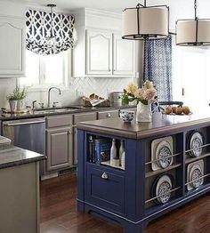 Interesting multi-tone kitchen cabinets + island