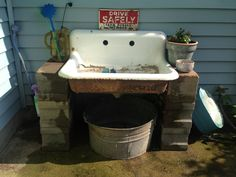 sink that I put outside for a potting bench. I used concrete blocks to to mount it on. sink that I put outside for a potting bench. I used concrete blocks to to mount it on.