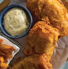 Host your own fish fry! Beer-Battered Cod is the perfect centerpiece. Don't forget the tartar sauce, lemon slices and the cole slaw and potatoes.