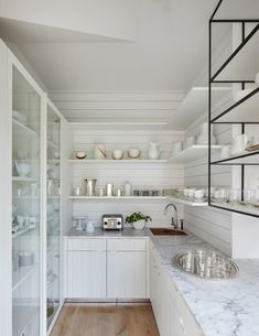 A unique, stunning approach to a classic white kitchen. Be inspired by Fresh Start a Sub-Zero, Wolf, and Cove Transitional Kitchen Design Contest Finalist. Glass Door Refrigerator, Refrigerator Freezer, Closed Kitchen Design, Ventilation Hood, Classic White Kitchen, Farmhouse Style Table, Surf House, Whitewash Wood, Transitional Kitchen