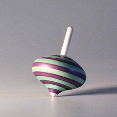 Purple & Turqouise striped spinning top turnip by davidturnsbowls. via Etsy.