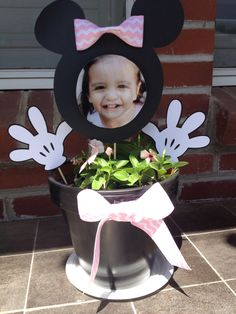 Minnie Mouse little girl party decorations in a pot with planted flowers.