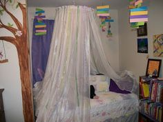Bed Canopy from Hula Hoop, ribbon, and sheer curtains.