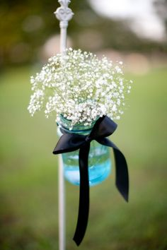 Baby's breath, gypsophila in mason or jam jars - Simple, cute and very cost effective #wedding flowers.