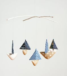 $55 sailboat mobile from @madeleinesargent on #esty. i love the simplicity and softness of it.