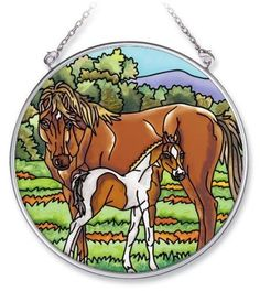Amia 5474 Horse and Foal Design Hand-Painted Glass Suncatcher with Chain, 4-1/2-Inch Circle by Amia. $13.00. Handpainted glass. Comes boxed, makes for a great gift. Includes chain. Amia Glass is a top selling line of handpainted glass decor. Known for tying in rich colors and excellent designs, Amia has a full line of handpainted glass pieces to satisfy your decor needs. Items in the line range from suncatchers, window decor panels, vases, votives and much more.