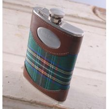 """Green Plaid 8 oz. Flask  Whether they fill it with a wee bit of Scotch Whiskey or any other favorite libation, this Scottish-themed personalized green plaid flask is the perfect present for a number of occasions, including birthdays, retirements, and as groomsmen gifts. Adorned with rich brown leather, our personalized flask has an easy to open cap and is small enough to fit in a jacket pocket. Holds 8 ounces. Measures 6"""" x 4"""" x ¾"""". Personalized with two lines of up to 15 characters per…"""