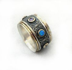 Spinner ring for woman three spinners one wide by ilanamir on Etsy, $230.00  https://www.etsy.com/ca/listing/152870935/spinner-ring-for-woman-three-spinners?ref=sr_gallery_24&ga_includes%5B0%5D=tags&ga_search_query=spinner+ring&ga_page=13&ga_search_type=all&ga_facet=spinner+ring&ga_view_type=gallery