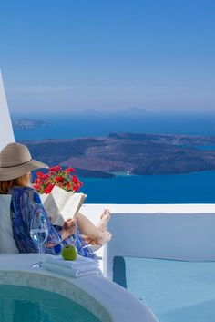 A Santorini Summer's Day, Greece This is exactly where I'd like to be sitting and reading.... ah, memories!