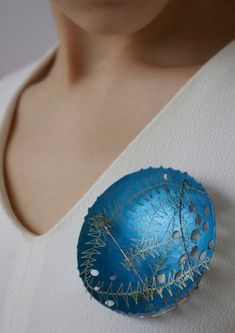 Karen Elizabeth Donovan, Edinburgh College of Art; 'Highland Clan Badges: Murray' in titanium and steel, modelled - Kath Libbert Jewellery Gallery -YOUTH MOVEMENT!