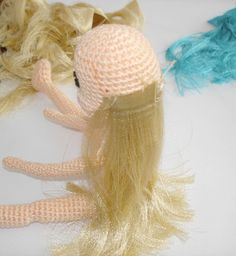 "Amigurumi Tutorial: How to Make Doll's Hair from Satin Ribbon - PDF File, click ""Doll's hair from satin ribbon"" here: http://amigurumibb.wordpress.com/help-page-tutorials-and-tips/"