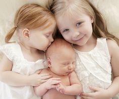 newborn photo with older siblings