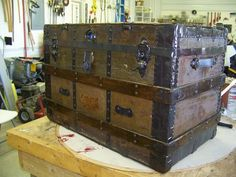 I have a steamer trunk a bit like this one that I picked up at an estate sale. It currently sits at the foot of my bed and holds random junk, but I'm thinking about using it as a coffee table.