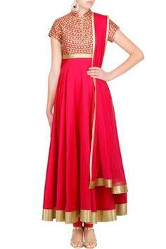 Featuring a bindi applique fuschia chanderi silk anarkali with a golden border…