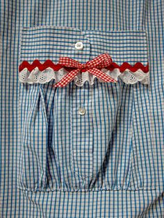 This looks like a sleeve and cuff piece from a dress shirt made into a pocket!  Love this idea for an apron.