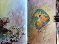 The left page was a magazine, the right is a fish drawn by me.  The coloring is watercolor paint.