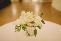 Cabaret table decor featuring narcissus, freesia, and hyacinth. Photo by Dark Roux Photography
