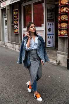 Adore this look - knit midi skirt, and denim jacket. The orange accent on the shoes is amazing