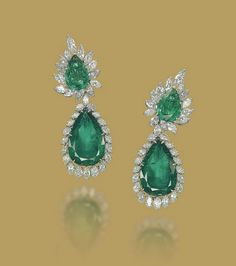 A PAIR OF EMERALD AND DIAMOND EAR PENDANTS, BY HARRY WINSTON   Each top set with a pear-shaped emerald in a marquise-cut diamond surround, suspending a detachable pendant set with a larger pear-shaped emerald in a pear and marquise-shaped diamond surround, mounted in platinum, 6.8 cm  With maker's mark of Jacques Timey for Harry Winston