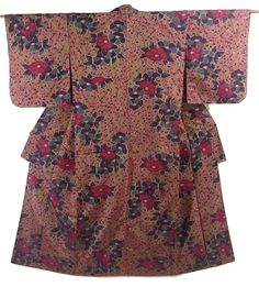 This is a Meisen Kimono with 'Tsubaki' (camellia) pattern on the dark yellow green background, which is woven