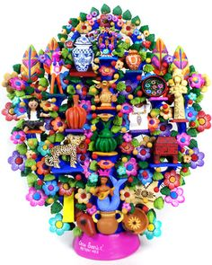 Mexican Folk Art Arbol de la Vida, by Oscar Soteno from Metepec, Mexico. This is a gorgeous example of Oscar's art. This beautiful tree features many of the most popular handicrafts created in Mexico. Laquerware, textiles, Talavera pottery, Tonala ceramics...even a little tree of life at the top!