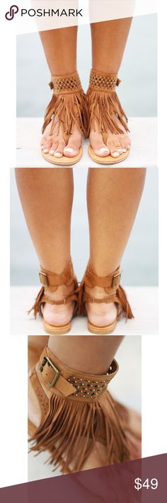 Tan Fringe Gladiator Sandals Have yourself a stellar summer in these sandal! Fringe flows down the laser-cut design on the vamp, while 2 straps hold your foot in, all polished off with shiny stud details! These summer sandals are just out of this world! Fits true to size Fringe detail Studs Side buckle Elastic at back Color: Tan Not Rated Shoes Sandals