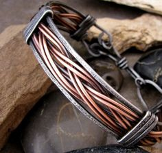 Mens Iron and Copper Bracelet by TammysTreasureChest on Etsy, $32.00. Absolutely stunning design. Love the weaving and the mixed metals. Can't believe it is only $32!