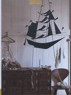 This is how a playroom should be. Full of natural curiosities and imagination. Love the Amazing black ship.