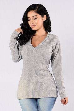 - Available in Oatmeal and Heather Grey - V Neck - Side Slits - Knit - 81% Polyester, 15% Rayon, 4% Spandex