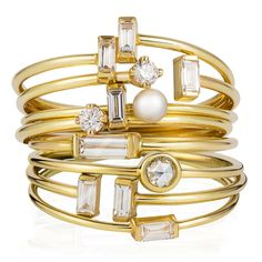 Stack of Sweet Pea 18ct yellow gold rings set with rose cut, brilliant cut and baguette cut diamonds and white pearl.