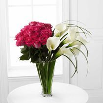 """Irresistible"" - A stunning contrast of hot pink roses and soft white calla lilies captures the imagination"