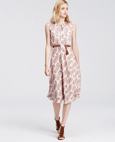 Image of Paisley Chiffon Tie Neck Midi Dress like the belted waist and the repeating motif pattern