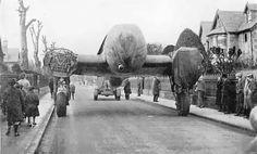 WW2: A downed Luftwaffe Heinkel 111 H-1 bomber is towed along Dirleton Avenue in North Berwick. (1940)