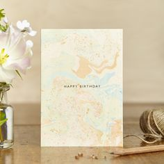 Original Marbled print card with gold foiled 'Birthday' greeting. The card is accompanied by a luxury gold polka dot envelope. Matching gift wrap