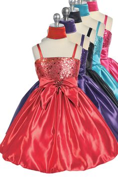 This trendy dress is ideal for dances, graduation, parties, holidays, birthday, or and other special event!  Spagetti strap satin dress Sequin bodice Bow inthe front Sash ties in the