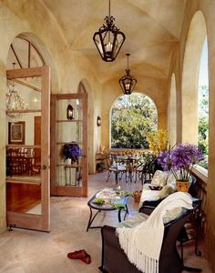 Stucco porch.  Outdoor living covered French Country porch.