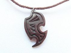 COCONUT SHELL PENDANT n1 Unisex handcarved wood di MassoGeppetto, €16.00