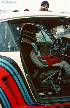 Jacky Ickx behind wheel of Martini Porsche 935