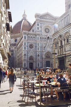 busy street with a view of the Duomo in Florence, Italy